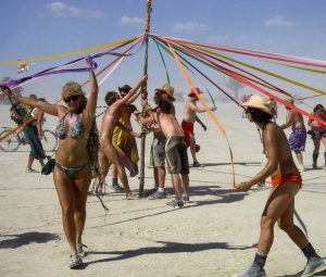 Dancing around the May Pole together.
