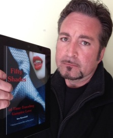 """Ned with an advanced copy of  """"50 Shades of Time-Traveling Vampire Love."""""""